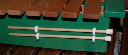 Keep xylophone mallets clipped to the box