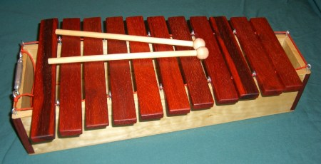 Using eyelets to suspend xylophone bars like in the  DIY marimba plans